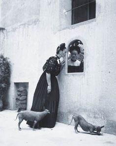 Frida Kahlo and her Itzcuintli dogs. Photograph c. 1944 by Mexican photographer Lola Alvarez Bravo.