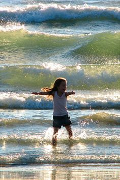 Your board name is perfect for this child.  Wonderful pleasure she is experiencing in the beautiful water.