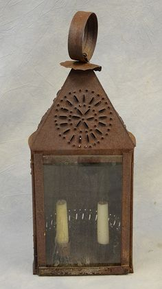 """Punched tin """"double candle"""" lantern with glass front, pierced star design, Pennsylvania, 19th C, oxidized rusted patina."""