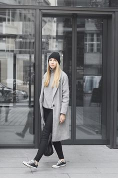 Classic black converse look their best when worn with darker colours. Pavlína Jágrová wears the trend with a pale grey sweater and coat matched with black jeans and a cute beanie. Coat: C&A, Sweater: Vintage, Trousers: Lindex, Shoes: Converse, Bag: Celine