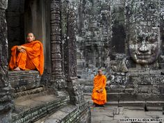 "Monks resting at Bayon Temple, Angkor, Cambodia, 2006  ""On my first day returning to Angkor Wat in Cambodia after 12 years I was initially dismayed to find the ancient ruins literally sinking under the weight of tourists. I discovered it was best to walk the ruins in the opposite direction of the tourists, when the monks come out to enjoy the quiet of the day."" Alison wright  http://travel.cnn.com/face-face-portraits-human-spirit-046291?iid=article_sidebar#"