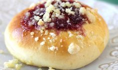 Learn how to make the soft, pillowy kolache pastries make of flaky bread with a custard filling, a plum jam glaze and a crunchy streusel topping.