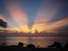 Amazing sunset on our honeymoon on Raratonga in the Cook Islands.   (The clouds were moving in two different directions!)