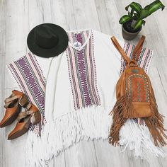 Perfect flatlay for your bohemian inspo. Featuring our Roam Free Poncho, Dreamer Leather Boots and Chameleon Bag.