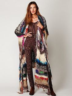 "Tangier Maxi Poncho | Amazing, multi-colored handspun maxi poncho sweater with fringe detailing. Super soft.   This piece is partially composed of leftover handspun yarn from India. Each piece will be slightly different as a result.  *40% Acrylic, 25% Wool, 15% Mohair, 10% Cotton  *For Best Results Dry Clean  *Import  Measurements for Size Small:  Length: Approx. 47""  Sleeve Length (from neckline): 26""  Width of Armhole Opening: 9"""