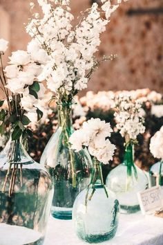 White Flowers in Glass Urns on Altar   Alago Events   Mallorca Wedding & Event Planner