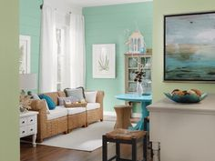 "Slight blue and green colors would give a ""coastal"" look which could work with the golden yellow and give some division in rooms."