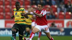 Rotherham United's Matt Derbyshire (right) and Norwich City's Sebastien Bassong battle for the ball