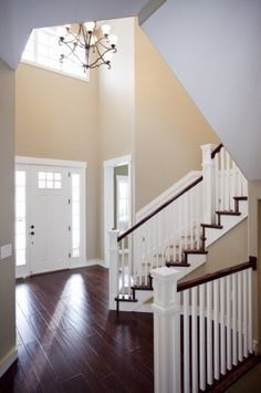 I LOVE the white banisters and dark railings