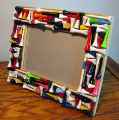Father's Day Gift: Golf frame ...cute idea for Grandpa. I like this idea, we sell tees at a bargain price for some Christmas craft.