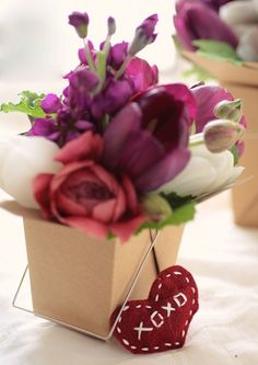 I love this idea of fresh flowers in a brown take-out box! Cheap and simple centerpiece for a backyard wedding.