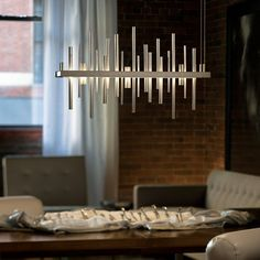 The Hubbardton Forge Cityscape LED Linear Suspension is composed of vertical cylinders of varying lengths with an LED light source beneath. With the cylinders extending above and below the base, the viewer Led Pendant Lights, Pendant Lighting, Light Pendant, Modern Lighting, Lighting Design, Entry Lighting, Lighting Showroom, Dining Lighting, Restaurant Bar
