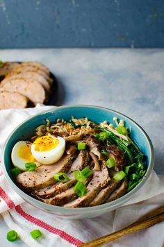 Easy Pork Ramen -Thinly sliced, perfectly cooked, juicy pork tenderloin and an egg with a gloriously runny egg yolk, crunchy Asian greens, and flavorful mushrooms, all swimming in a scrumptious and flavor-packed ramen noodle broth. All in less than 30 minutes!