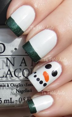Fast and easy Christmas/winter days mani - OPI My Boyfriend Scales Walls is the base. French tips done with Zoya Veruschka. The Snowman face is done with Zoya Raven for the eyes and mouth and Zoya Jancyn for the nose.
