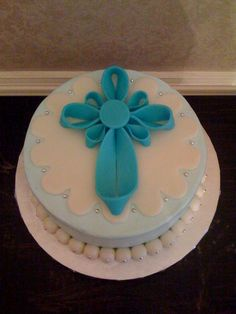 Baptism Cake- could make smaller version of fondant ribbon cross Baby Cakes, Fondant Cakes, Cupcake Cakes, Fun Cakes, Dedication Cake, Dedication Ideas, Bible Cake, Confirmation Cakes, Baptism Cakes