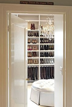 my dream shoe closet. love the hanging boots.