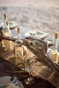 Add note to sand in bottle, a candle to top of bottle and makes great table centerpiece