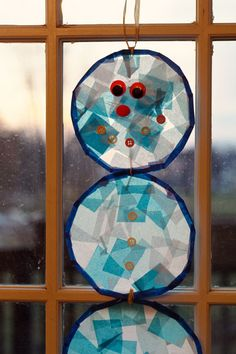 Stained Glass Snowmen Craft - This should be very do-able for my snowman-loving toddler!