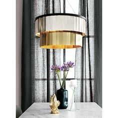 Armour Chandelier is a ring of light with glinty metallic fringe that shimmers all around two-tiers. Mix the metals in your own spontaneous pattern of cool and warm to create a DIY glow.