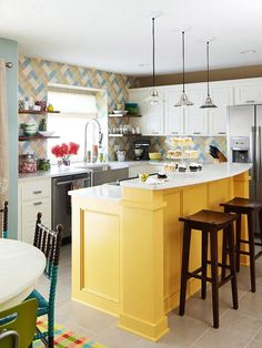 When these homeowners decided to make over their kitchen they knew they wanted to add tons of color and personality. Now, bold colors make this kitchen pop and stand out in style. They make this bright kitchen work by balancing muted tones on kitchen walls with brighter colors for accents.