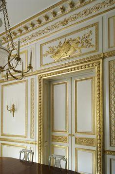 Boiserie de style Louis XVI pour une salle à manger dans un appartement londonien