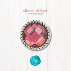 The shimmery red tones catch the light and reflect back to you the entrancing shades of the 12 mm Garnet Solitaire.