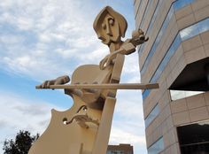 What do you think of this cello-player sculpture at The Lyric Center Office Tower in TX? #cello #cellist #sculpture