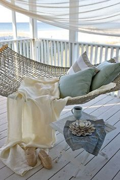 Patio pillows - mix up the beige stripe pillows with duck egg plain fabric pillows..