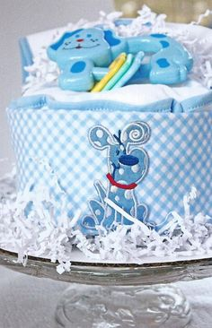 CREATIVE WAY TO USE PAPER SHREDS - BE SURE TO DISPLAY ON CAKE STAND    Blue Doggy Diaper Cake  Blue Gingham  Boy by ImagineThatBaby, $55.00