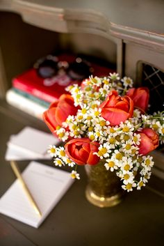 Beautiful and simple flower arrangement of tulips and daisies for your home office our boudoir