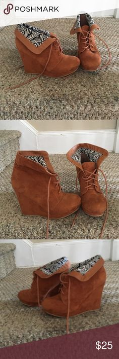 Suede ankle booties with fold over Aztec detail Brown suede ankle booties with Aztec trim. 4 in wedge heel, size 7, EUC. Charlotte Russe Shoes Ankle Boots & Booties