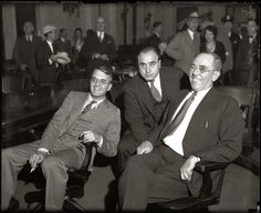Al Capone, center, in federal court in Chicago during his 1931 tax-evasion trial, with lawyers Michael Ahern, left and Albert Fink. — Chicago Tribune historical photo