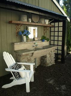 Our outdoor garden sink with hot and cold running water, cement counter top, recycled concrete.... Provence Style....