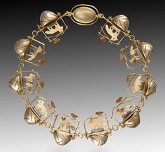 carolyn morris bach, 18k gold, sterling silver, hand-carved elements