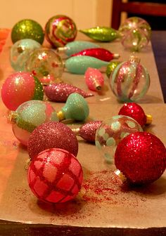 Check out Anna Maria Horner's great Christmas decorations...just add glue and glitter to old bulbs and ornaments.  My fav. artist!