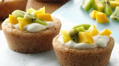 Kiwi, pineapple and mango provide a delicious topping to these almond sugar cookie cups filled with Yoplait® yogurt.