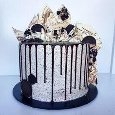 Layers of Devils food chocolate cake with crushed Oreo's between the layers, covered in Oreo buttercream, a dark chocolate ganache drip & marbled Oreo chocolate shards.  This is the ultimate cookies & Cream cake perfect for any occasion!
