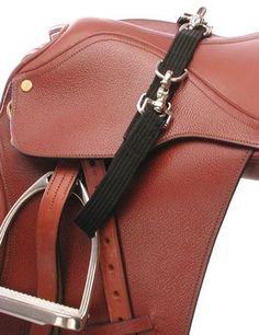 Tough-1 No Bounce Stirrup Tiedown. Great for lunging when you don't want your stirrups to fall down and hit your horses sides.