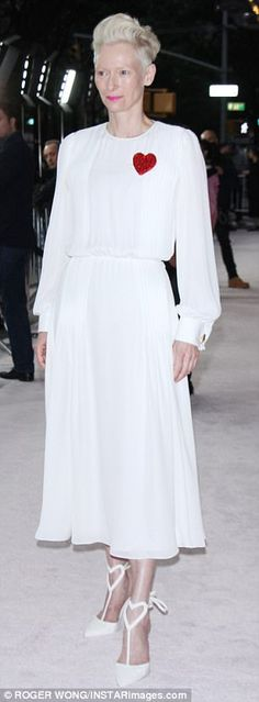 Polar opposites: Swinton opted for a heavenly all white frock with heart designs...