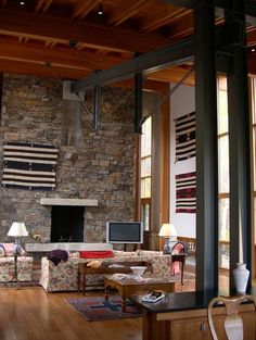 Love the steel beams, stone, wood floors and light