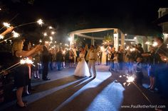 For the Love of Mackinac Wedding Planning sparkler send off at Mission Point Resort photo by Paul Retherford Wedding Photography