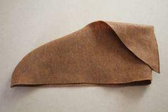 Step 3: Fold Over Fold the flap over the boot. The wearer's foot goes through the ankle opening. The shoe cover can be worn with any type of shoe.