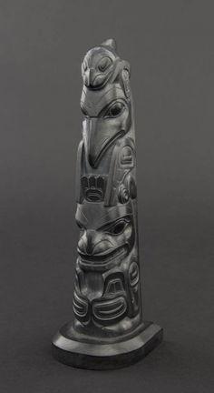 Robert Davidson, a carved argillite totem pole depicting Killer whale, Raven, and Killer whale,  signed to the base Davidson Jr. and HAIDA ART  SOLD FOR $21,850 (April 2014)
