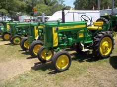 John Deere 2-cylinders r-l: 320.420,Model M & 420T tricycle.This is either 320 or 420