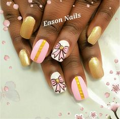 Gold and pink bow manicure