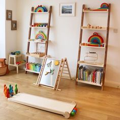 Playroom ladder shelf with Grimm's rainbows, pikler triangle and skittles. Love the ladder shelves Ladder Shelf Decor, Ladder Bookcase, Cool Kids Rooms, Montessori Room, Big Move, Kids Playing, Playroom, Nursery, Grimm