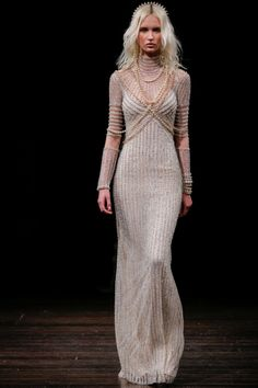 c2ecb2699437 Beaded high neckline form fitting long sleeve Naeem Khan wedding dress   http