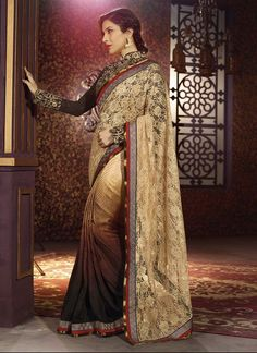 Add richer looks to your persona in this Sophie Chaudhary brown satin, net and jacquard designer saree. The lovely embroidered, lace and resham work throughout the attire is awe inspiring. Comes with ...