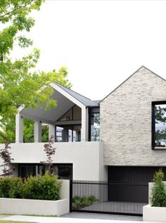 Sunset House presents a thoroughly modern and welcome presence on its generous corner block in Deepdene. It's restrained grey palette of handcrafted Petersen D91 bricks creates a stunning display of feature brickwork, while black steel provides a crisp and contrasting accent, all offset by a simple grey render.  Image: Justin Alexander Grey Brick Houses, Modern Brick House, Modern Exterior House Designs, Black House Exterior, Modern Farmhouse Exterior, Modern House Design, Exterior Design, Exterior Rendering, Rendered Houses