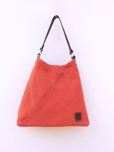 Another juicy colour- mandarin- of TATYZ signature triangle bag.Secret inside!
